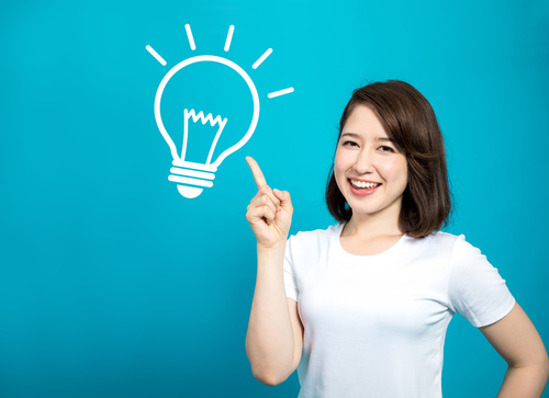 idea and inspiration. young woman and electric bulb symbol illus