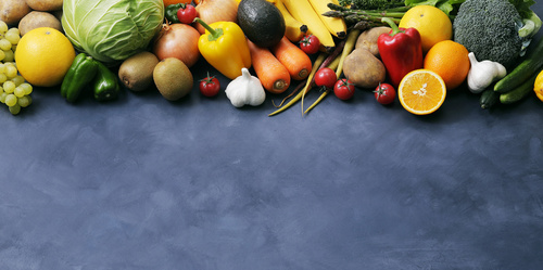 Image of different fruits and vegetables on dark background